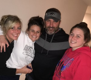 Crystal hugs her dad & sisters before her trip to Mayo...